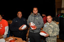 Maurkice Pouncey flashes a smile at a turkey giveaway in November.