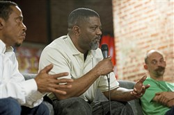 Julius Drake, center, of Homewood speaks during the Repair the World Pittsburgh panel discussion Thursday in East Liberty. Anthony Parks of Highland Park, left, and Josh Inklovich, right, of Garfield also spoke on the panel.
