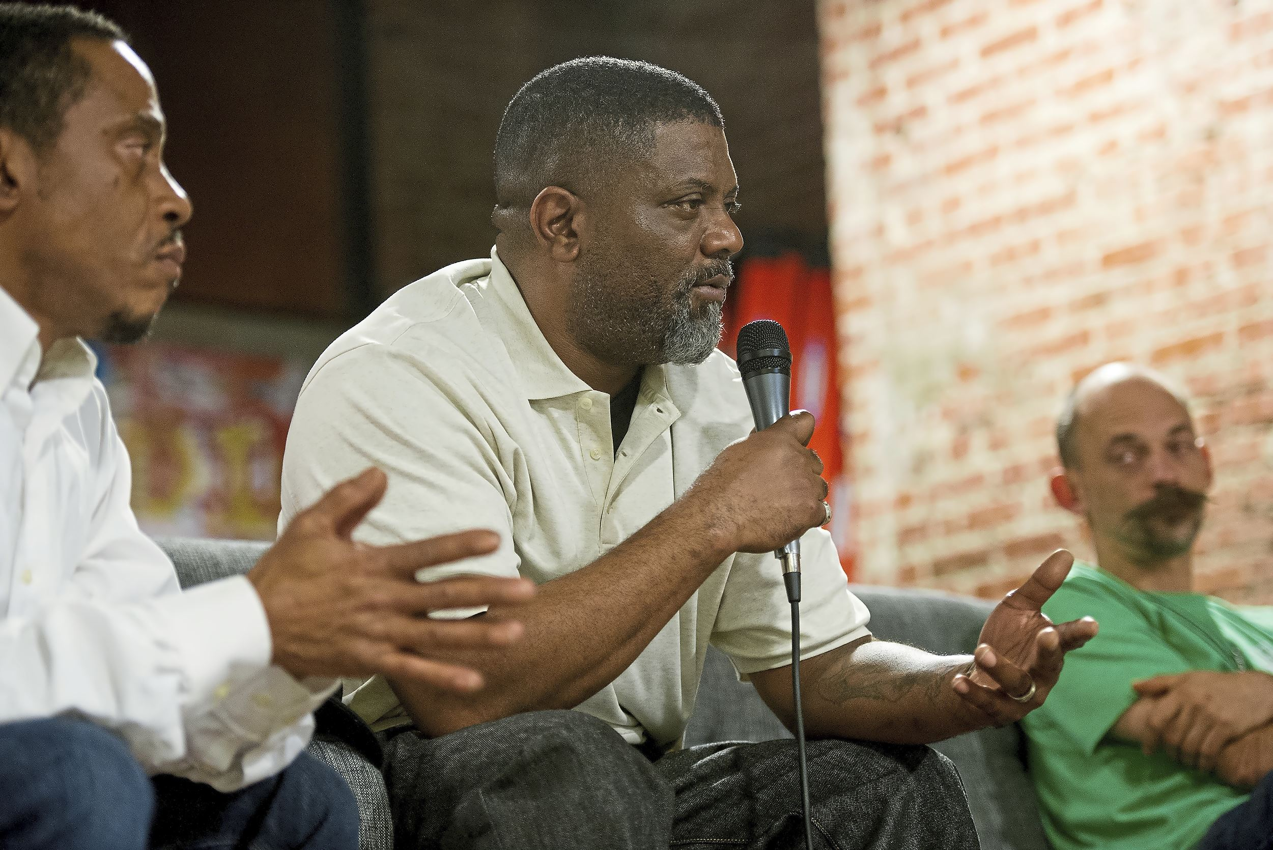 20171130rldRepairWorld01 Julius Drake, center, of Homewood speaks during the Repair the World Pittsburgh panel discussion Thursday in East Liberty. Anthony Parks of Highland Park, left, and Josh Inklovich, right, of Garfield also spoke on the panel.