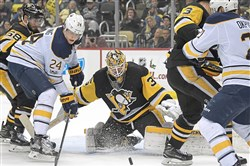 Pittsburgh Penguins goalie Tristan Jarry makes a save on Buffalo's Hudson Fasching Saturday at PPG Paints Arena.
