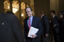 Sen. Pat Toomey, R-Pa., a member of the tax-writing Senate Finance Committee, and other Republican senators gather Friday to meet with Senate Majority Leader Mitch McConnell, R-Ky., on the GOP effort to overhaul the tax code, on Capitol Hill in Washington.