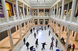 Skaters in December take to the white plastic as they glide about the Carnegie Museum of Art's Hall of Sculpture at the CMOA on Ice, a winter party held at the museum.