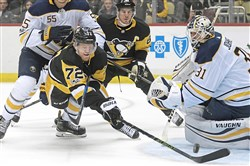 Patric Hornqvist dives after a puck on Saturday against the Sabres. (Peter Diana/Post-Gazette)