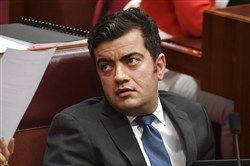 In this Dec. 4, 2017, file photo, Australia's Sen. Sam Dastyari attends question time in the Senate chamber at Parliament House in Canberra.