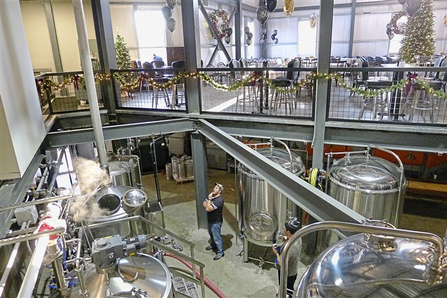 Bryan McDowell brews one of the first batches of beer at CR Brewing Co. in Neshannock, near New Castle. The 20,000-square-foot addition to the Crane Room Grille complex features a basement brewhouse that's open to the seating and banquet space upstairs.