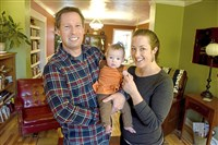 Steve Rodgers and Marah Hall with their 5 1/2-month-old daughter, Tomma, inside their Bloomfield home, a finalist in the 2016-17 Renovation Inspiration Contest.