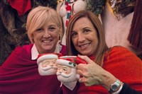 Joyce Hutterer, left, of Saxonburg and her friend Anita Morrill of Jacksonville, Fla., sip a Bad Santa, a mulled wine and port cocktail, at the Miracle on Market in the Original Oyster House on Market Square.