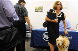 In 2012, Lisa Motta walked with her guide dog, Jazz, while attending a job fair for people with disabilities at the Office of Vocational Rehabilitation in Downtown. On Wednesday, Ms. Motta was one of four people that addressed a U.S. Senate special committee about discrimination issues facing older and disabled people in the workplace.