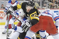 Pittsburgh Penguins Sidney Crosby is pulled down by Rangers Marc Staal Tuesday, December 5, 2017, at PPG Paints Arena in Pittsburgh.