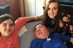 Ryan Briggs of Export will be one of the first patients evaluated for Pennsylvania's medical marijuana program. Ryan, 17, had a serious brain injury at birth and suffers multiple seizures daily. Here he is with sisters Hailey, 12, and Alexis, 21.