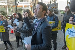 Aaron Anthony of Shaler chants slogans with others who were decrying proposed tax legislation outside U.S. Sen. Pat Toomey's office on Wednesday in Downtown. Graduate students from the University of Pittsburgh and led by the USW Graduate Student Organizing Committee, rallied outside Mr. Toomey office to voice their concern over proposed tax legislation.