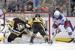 Pittsburgh Penguins Tristan Jarry makes save on Rangers Jimmy Vesey in the first period Tuesday, December 5, 2017, at PPG Paints Arena in Pittsburgh.