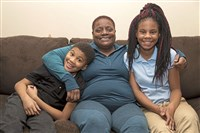 Keontay Copeland, 9, Tracy Copeland and Malaika Copeland, 14, share a light-hearted moment in the family's McKees Rocks home.