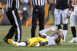 Pittsburgh Steelers inside linebacker Ryan Shazier lies on the field after an apparent injury in the first half of an NFL game against the Cincinnati Bengals on Dec. 4 in Cincinnati.
