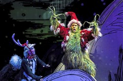 "Philip Bryan as The Grinch and the 2016 company of ""Dr. Seuss' How the Grinch Stole Christmas! The Musical."""