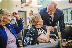 Gov. Tom Wolf talks with Mary Miketic, center, and Dorothy Heneroty, left, after speaking about the state's new Community HealthChoices program at the Stephen Foster Community Center in Lawrenceville.