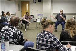 Jeffrey Draine, right, teaches a class in social justice for graduate level social work students at the Temple Center City Campus on November 18, 2017.