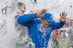Jeannette head coach Roy Hall reacts after being doused with water by Jeannette's Anthony Johnson after beating Homer-Center 42-12 during the PIAA Class A championship last Thursday.