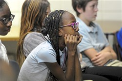 Alayzia Edmonds, a sixth-grader at Woodland Hills Intermediate school listens during a Leaders In Training session at the school Friday, December 8, 2017.