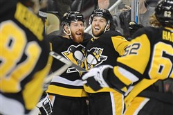 Pittsburgh Penguins Riley Sheahan celebrates his goal with Ian Cole in the third period against the Islanders Thursday, December 7, 2017, at PPG Paints Arena in Pittsburgh.  (Peter Diana/Post-Gazette)