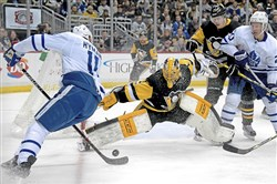 Penguins goalie Casey DeSmith makes save on Maple Leafs forward Zach Hyman in the second period Saturday at PPG Paints Arena.