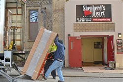 Volunteers with the 911th Airlift Wing of the Air Force Reserve Command and residents of Shepherd's Heart Veteran's home unload new furniture for 15 bedrooms for the residence in uptown Saturday, December 9, 2017 in Pittsburgh.