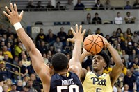 Pitt's Marcus Carr puts up a 3-point shot against West Virginia's Sagaba Konate in the second half at Petersen Events Center Saturday. (Matt Freed/Post-Gazette)