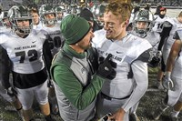 Pine-Richland coach Eric Kasperowicz and quarterback Phil Jurkovec share a moment after the Rams defeated St. Joseph's Prep for the PIAA Class 6A championship.