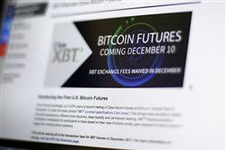This Dec. 8, 2017, file photo shows the Chicago Board Options Exchange website announcing that bitcoin futures will start trading on the CBOE on the evening of Dec. 10.