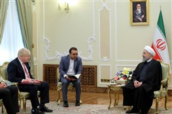 A handout picture provided by the office of Iranian President Hassan Rouhani on December 10, 2017, shows him (R) meeting British Foreign Secretary Boris Johnson in the capital Tehran.