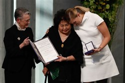 Berit Reiss-Andersen (L), chairperson of the Norwegian Nobel Committee, hands over the 2017 Nobel Peace Prize to Beatrice Fihn (R), leader of ICAN (International Campaign to Abolish Nuclear Weapons), and Hirsoshima nuclear bombing survivor Setsuko Thurlow (C) during the award ceremony of the 2017 Nobel Peace Prize at the city hall in Oslo, Norway, on December 10, 2017.