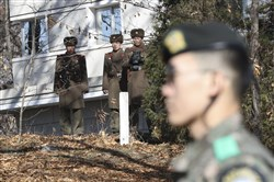 In this Nov. 27, 2017, file photo, North Korean soldiers look at the South side as a South Korean stands guard near the spot where a North Korean soldier crossed the border Nov. 13 at the Panmunjom, in the Demilitarized Zone, South Korea.