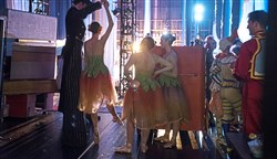 "Ian Rafferty, 23, wearing stilts as the ringmaster, helps a ballerina twirl backstage at a dress rehearsal of ""The Nutcracker"" at the Benedum Center, Downtown."