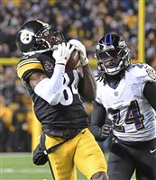 Steelers wide receiver Antonio Brown beats Ravens cornerback Brandon Carr Sunday night at Heinz Field.