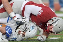 IUP linebacker Nick Amendola, a graduate of Norwin, sacks West Florida quarterback Mike Beaudry in the Division II semifinal game.