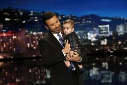 "This Dec. 11, 2017, image released by ABC shows host Jimmy Kimmel with his son Billy on ""Jimmy Kimmel Live!"" Kimmel held his baby son as he returned to his late-night show after a week off for the boy's heart surgery. Kimmel kept up his ardent advocacy Monday night, urging Congress to restore the Children's Health Insurance Program, which has been left unfunded and stuck in a political stalemate since September."