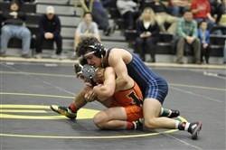 Franklin Regional's Colton Camacho, behind, gave Jefferson-Morgan's Gavin Teasdale all he could handle Saturday in the Eastern Area Invitational Tournament 132-pound final. Teasdale pulled out a 4-3 win to remain unbeaten (126-0) for his career.