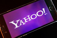 In this Dec. 15, 2016, file photo, the Yahoo logo appears on a smartphone in Frankfurt, Germany. Watching NFL games free on your phone used to be mainly limited to Verizon customers. Soon anyone will be able to download Yahoo's app and watch football games on the go. Verizon's new deal with the NFL goes into effect in January 2018 and will last for several years. Verizon bought Yahoo in June 2017 and is trying to build a digital ad business to rival Facebook and Google.