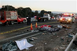 This is a picture taken at the scene of a road accident in Santa Rita Tlahuapan, Puebla, on the Mexico City-Puebla highway in Mexico on December 12, 2017, where at least 11 pilgrims died on their way back after visiting the Virgin of Guadalupe Basilica in the Mexican capital.