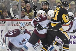 Avalanche goalie Jonathan Bernier makes save on Pittsburgh Penguins Evgeni Malkin Monday, December 11, 2017, at PPG Paints Arena in Pittsburgh.