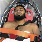 This photograph provided by a city employee shows Akayed Ullah, the suspect in the subway terror attack, in an ambulance after his apprehension on Dec. 11, 2017.  On the surface, Ullah seemed to be an ordinary member of a Bangladeshi enclave in Brooklyn, but on Monday morning, he strapped a pipe bomb to his body and set out to detonate it in a Times Square subway station, according to police.
