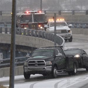 A tow truck and emergency crews clear the scene of an accident on Tuesday near Beaver Avenue on the North Side.
