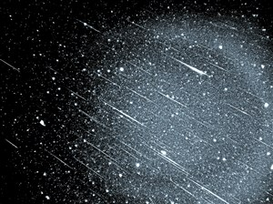On the morning of November 17, 1966, skywatchers in western North America were spellbound by an awesome flood of Leonid meteors peaking around 5 a.m. Mountain Standard Time. It was probably the greatest meteor shower of the 20th century. At New Mexico State University Observatory, A. Scott Murrell used a camera tracking the stars to capture this 10- to 12-minute exposure with a 50-mm f/1.9 lens and Kodak Tri-X (ISO 400) film. The bowl of the Little Dipper is at bottom. Click on the image to download a publication-quality version (6.2-megabyte TIFF) by FTP. Photo by A. Scott Murrell/NMSU; courtesy Sky & Telescope.