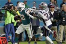 Patriots free safety Devin McCourty attempts to stop Miami running back Kenyan Drake during the second half Monday.