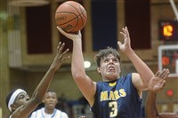 Mike Carmody (3) is a sophomore on the Mars basketball team, but was offered a football scholarship by Pitt.