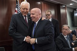 House Ways and Means Committee Chairman Kevin Brady, R-Texas, center, embraces Senate Finance Committee Chairman Orrin Hatch, R-Utah, left, after GOP leaders announced they have forged an agreement on a sweeping overhaul of the nation's tax laws on Capitol Hill in Washington on Dec. 13, 2017. Rep. Richard Neal, D-Mass., ranking member of the House Ways and Means Committee, looks on at far right.