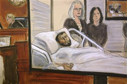 In this courtroom sketch, defendant Akayed Ullah is seen on a video monitor from his hospital room, joined by his attorneys, federal defenders Amy Gallicchio, left, and Juliet Gatto, on Dec. 13, 2017, in New York.