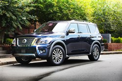 "Driver's Seat 12.14  for the review of the 2018 Nissan Armada.  The 2018 Nissan Armada is certainly a large and handsome vehicle, and allows people the feeling of king of the road.     For 2018, a new Armada Platinum Reserve model is offered – with Dark Chrome exterior trim (front grille, door handles, outside mirrors), 20-inch Dark Chrome wheels, two-tone leather-appointed seats with unique stitching, unique Black Quartz and premium wood tone interior trim, and an embossed ""Platinum Reserve"" emblem on the console lid. For the first time on any Nissan vehicle, the Armada Platinum and Platinum Reserve models will have a standard Intelligent Rear View Mirror."