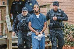 Rahmael Sal Holt, 29, charged in the shooting death of New Kensington police Officer Brian Shaw, is led Wednesday from District Judge Frank J. Pallone Jr.'s office in New Kensington. Holt, of Natrona Heights, was ordered to stand trial on homicide and other charges after a preliminary hearing.