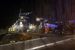 In this photo provided by France Bleu, rescue workers help after a school bus and a regional train collided in the village of Millas, southern France, on Dec. 14, 2017.